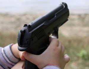 1335194556nino-gun-arma