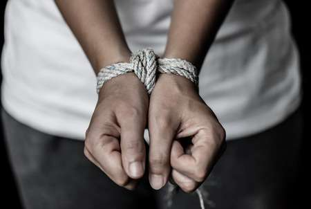 91295512-stop-violence-against-women-hands-were-tied-with-a-rope-violence-terrified-human-rights-day-concept-